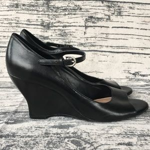 Very unique black wedge open toe heels.
